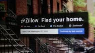 The Zillow Inc website is arranged for a photograph in Washington DC Close up shots of a mouse cursor clicking through the Zillow website and...