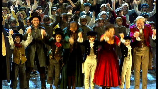 New production of musical 'Oliver' curtain calls and interviews ENGLAND London Theatre Royal INT Rowan Atkinson and Jodie Prenger taking curtain call...