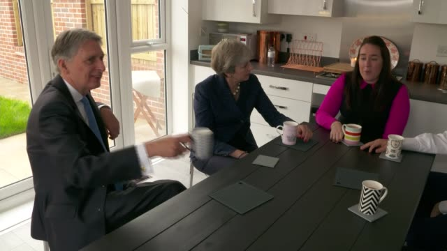 Theresa May and Philip Hammond visit housing estate ENGLAND Greater Manchester Walkden EXT Cars arriving / Theresa May MP and Philip Hammond MP along...
