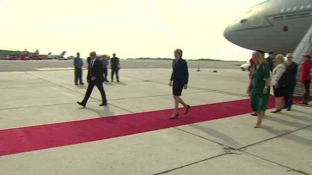 Ontario Ottawa EXT Theresa May MP down steps from plane and along to car / May along on red carpet with Justin Trudeau at Parliament Hill / May...