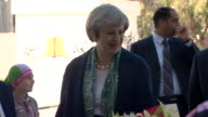 Theresa May being welcomed at a secondary school during an official visit to Jordan