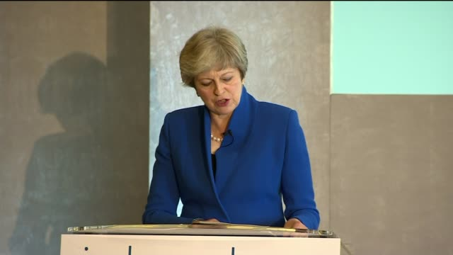 Theresa May defends free market in Bank of England speech Bank of England INT Theresa May MP shaking hands with Mark Carney and up to podium Theresa...