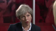 Theresa May describing the Grenfell Tower fire as 'absolutely awful' and saying victims have been left with 'absolutely nothing'