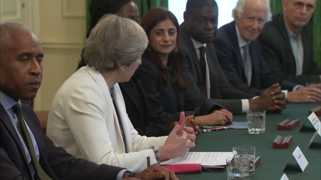 Theresa May hosts roundtable meeting ENGLAND London Downing Street INT Theresa May MP hosting meeting with Sajid Javid MP and others