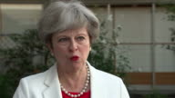 Theresa May saying she is 'here for the long term' and that her government wants to deliver Brexit and 'a brighter future for the United Kingdom'