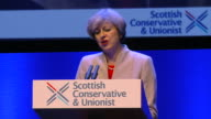 Theresa May saying 'we are four nations but at heart we are one people' at the Scottish Conservative conference in Glasgow