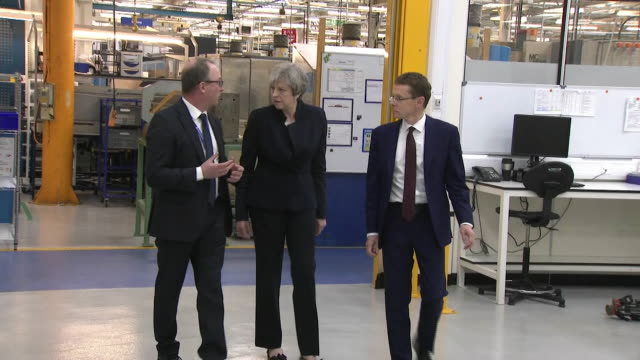 Theresa May touring an aerospace factory with new West Midlands mayor Andy Street in Wolverhampton