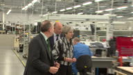 Theresa May visiting a factory in Enfield on the general election campaign trail