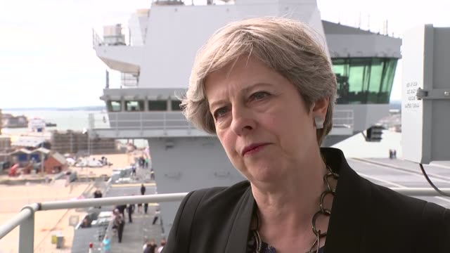 Theresa May visits HMS Queen Elizabeth at Portsmouth Naval Base Interview tour and cutaways of speech ENGLAND Hampshire Portsmouth Portsmouth Naval...