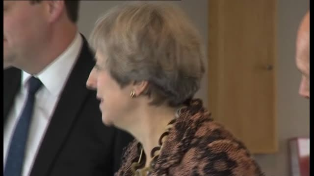 North Yorkshire Teesside Teesport EXT Theresa May MP arriving and greeted by Ben Houchen May and Houchen sat with members of the South Tees...