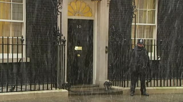 Theresa May vows to carry on amid rumours of leadership challenge T06011001 / TX EXT Snow falling outside Number 10 and old fashioned street lamp...