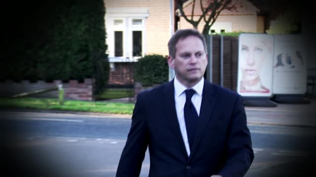 Theresa May vows to carry on amid rumours of leadership challenge Hertfordshire Welwyn Garden City Grant Shapps MP walking shot/ GRAPHICISED SEQUENCE...