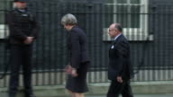 Theresa May welcoming French Prime Minister Bernard Cazeneuve to Downing Street