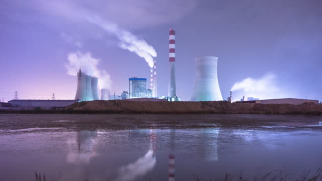 thermal power plant reflcetion in water  at night ,timelapse,4k