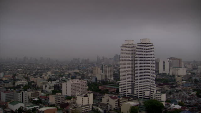 A thick bank of fog hangs over Manila. Available in HD.