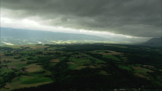 AERIAL Thick black clouds over fields, Seyssel, Rhone Alpes, France