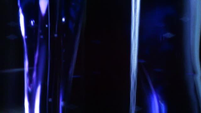 Thick transparent blue liquid goo pours down.
