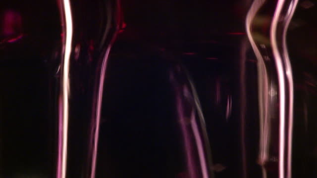 Thick transparent pink liquid goo pours down.