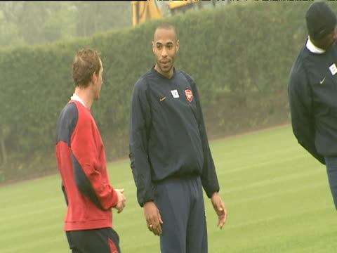 Thierry Henry and Ray Parlour joke and laugh watched by Sol Campbell Arsenal FC training session London Colney 18 May 04