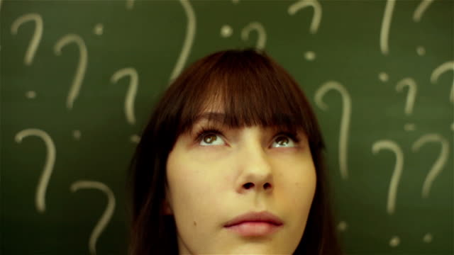 thinking woman in classroom