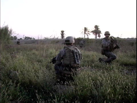 Third Infantry Division US soldiers kneeling in field at dawn / Arab Jabour Iraq / AUDIO