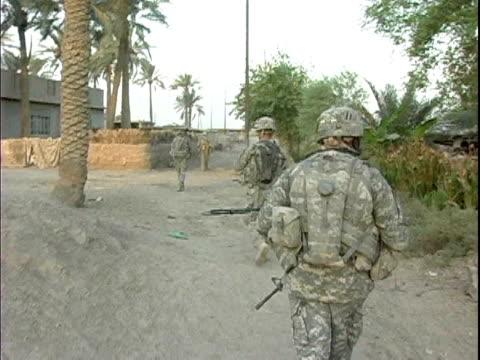 Third Infantry Division US soldiers patrolling rural village / Arab Jabour Iraq / AUDIO