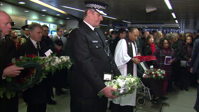This clip contains a black gap third party content removed VOICED Hundreds of people gathered at King's Cross station in London today to remember 31...