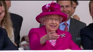 This clip contains background music which may require additional clearances CLEAN Exterior shots of the Queen smiling as she watches a parade along...