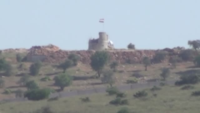 This footage taken from Turkey's Kilis province on May 11 2017 shows Russian and Syrian flags flying in Aleppo's Afrin district which is held by the...