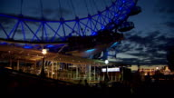 This timelapse takes place at night looking at the London Eye from the South Bank of the River ThamesThis shot shows the London Eye rotating from the...