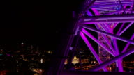 This timelapse takes place at night on the London Eye on the South Bank of the River ThamesThis shot shows parts of the metal work passing through...