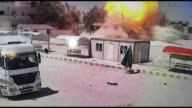 This video footaged by security camera from Mursitpinar border crossing of Turkey's Sanliurfa province at Turkey's Syria border shows smoke rises...
