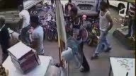 This video footaged by security camera shows that a pitbull dog attacks a boy his father and people save him from the dog attack at a local market in...