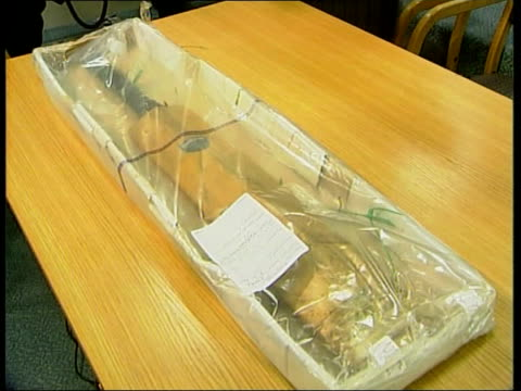 Jane Andrews convicted ITN ENGLAND London Cricket bat used by Andrews to strike Cressman wrapped in plastic Knife used by Andrews to stab Cressman...