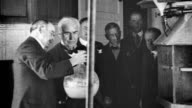 Thomas Edison touring General Electric factory looking at experimental purification of metals in chemistry lab Thomas Edison visiting General...