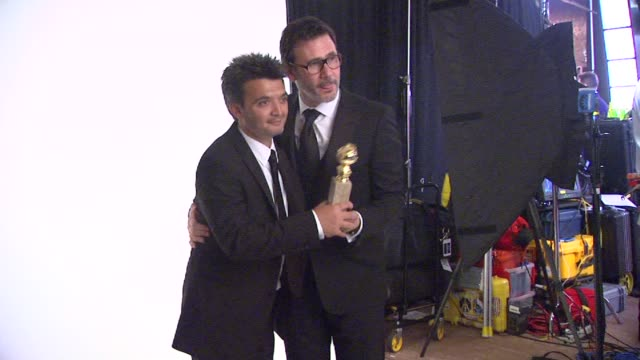 Thomas Langmann and Michel Hazanavicius at 69th Annual Golden Globe Awards Backstage Portrait Studio in Beverly Hills CA on 1/15/12