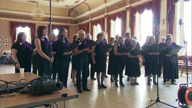 Thomas Mair jailed for 'terrorist' murder of MP Jo Cox ENGLAND South Yorkshire Batley INT Various of Batley Community Choir performing tribute song...