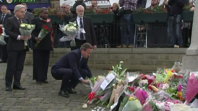 Thomas Mair jailed for 'terrorist' murder of MP Jo Cox T17061601 / TX David Cameron MP and Jeremy Corbyn MP along with flowers Close shots floral...