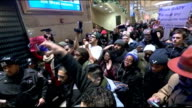 Thousands attend funeral of murdered police officer Rafael Ramos T04121404 Grand Central Terminal INT Various of protesters demonstrating against...