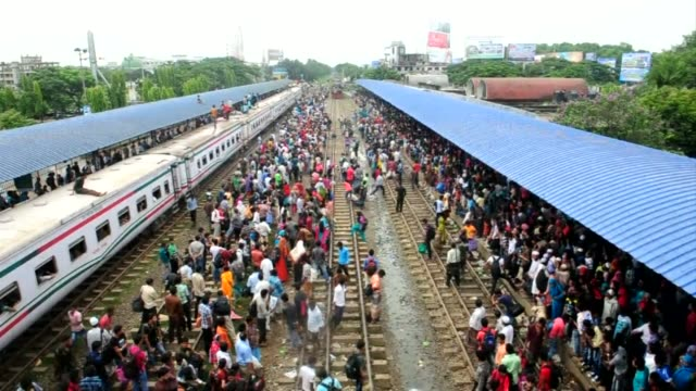 Thousands cram into and onto the roofs of trains in Bangladesh as people rush home to be with their families for Eid CLEAN Crowds cram onto roofs of...