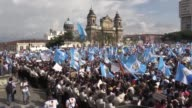 Thousands demonstrate Wednesday in the streets of the capital and in other cities around Guatemala in a national strike hoping to force the...
