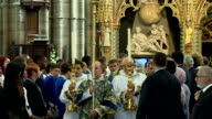 Thousands killed in the Srebrenica genocide 20 years ago have been remembered at a service in Westminster Abbey More than 8000 male Muslims were...