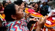 Thousands of Bangladeshi garment workers stage a tearful demonstration to mark the anniversary of a factory disaster that killed 1138 people...