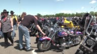 Thousands of bikers roar through Washington for the annual Rolling Thunder rally given added fervor this year amid anger over an ongoing scandal...