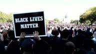 Thousands of black men women and children gathered on Washingtons National Mall Saturday the site of the Million Man March 20 years earlier calling...