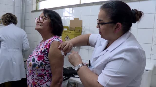Thousands of Brazilians rushed to vaccination clinics Wednesday after a monkey infected with yellow fever was found dead in a Sao Paulo park