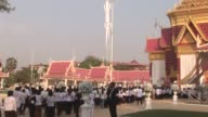 Thousands of Cambodians dressed in black and white gather ahead of the cremation of revered former king Norodom Sihanouk who steered the war ravaged...