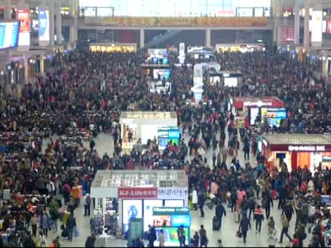 Thousands of Chinese people are seen at Beijing Railway Station on February 16 2015 during the world's most populous country's largest seasonal...