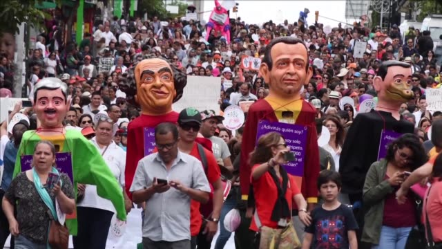 Thousands of demonstrators marched in Costa Rica's capital Friday to protest violence against women