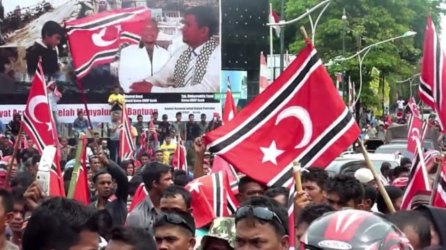 Thousands of demonstrators rallied in Indonesias Aceh on April 4 2013 in support of local leaders bid to adopt a separatist flag as the staunchly...